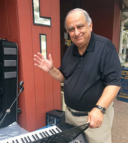 Vince Tavalario standing by a keyboard