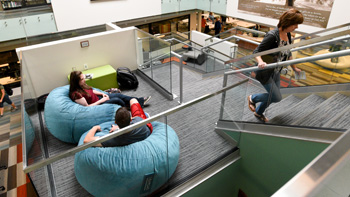 Students sitting on bean bag chairs in the Heaton Family Learning Commons.